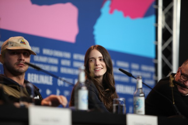 "Franco-english actress Stacy Martin at the Berlinale on 9 February 2014. Martin presented the film ""Nymphomaniac, Vol. 1"", in which she embodies the character of ""Young Joe"". To her left American actor Shia LaBeouf, to her right Swedish actor Stellan Skarsgård."